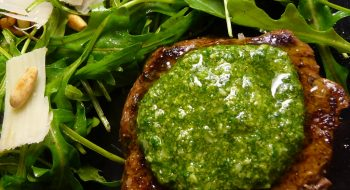 Marbled steak with pesto and salad
